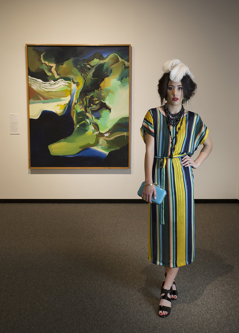 Dress, clutch and earrings from Shine. Vintage beads and plumes from Eclectic. Shoes from Tango's.  Artwork by Brain Strong (New Zealand, 1945-), Lake Series 10, Rotoiti, 1974, oil on canvas. Collection of The Suter Art Gallery Te Aratoi o Whakatu.