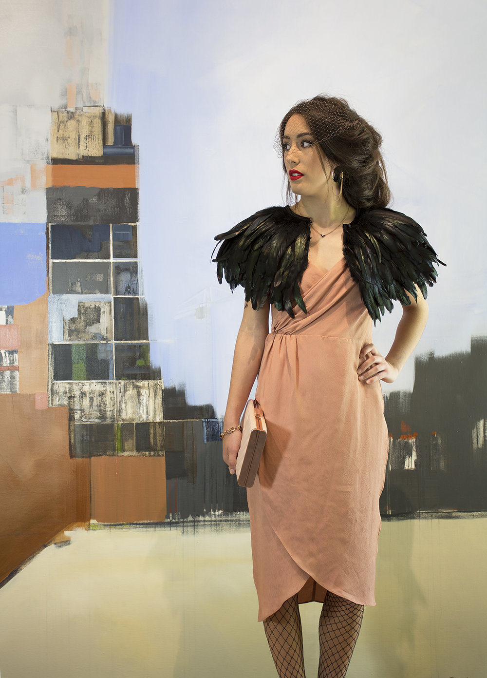 Dress, clutch and jewellery from Shine. Feathered cape from Dotti. Hosiery and hair netting, stylist's own.  Artwork by Lisa Chandler, We often lose today, because there has been a yesterday and tomorrow is coming, 2016, acrylic on linen. Courtesy of the artist.
