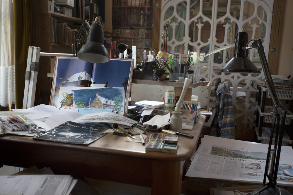 The office of the creative illustrator, shows evidence of numerous projects still in the middle of the creative process.
