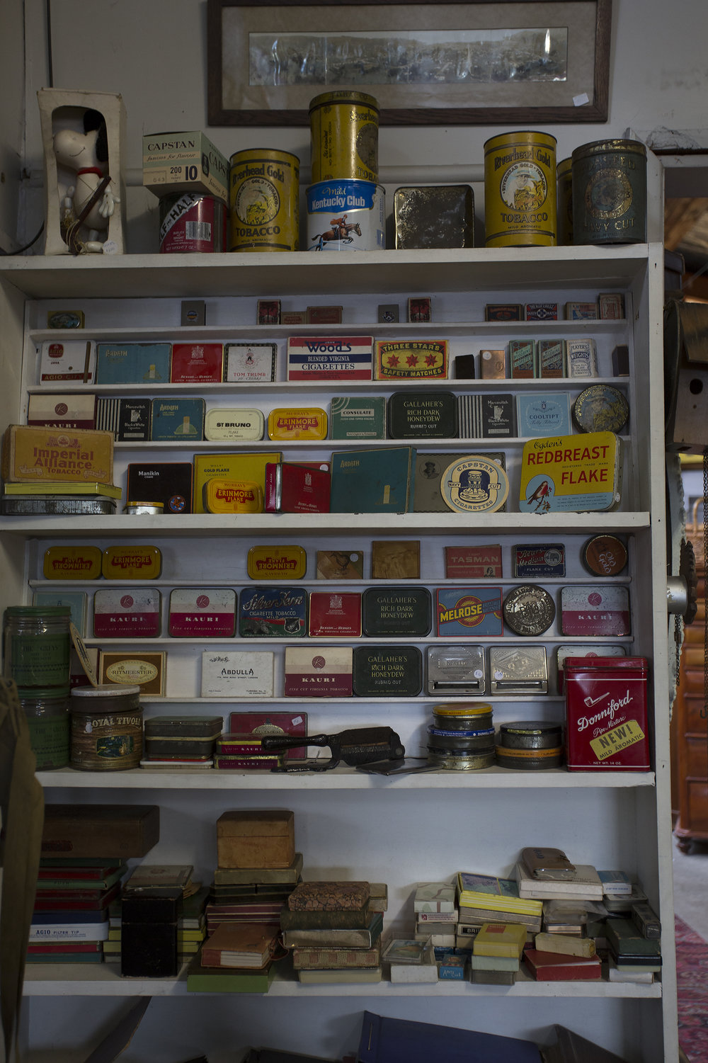 Tabacco tins line a shelf, a reminder of a once booming industry which provided work to many a Nelsonian in the local hop fields.