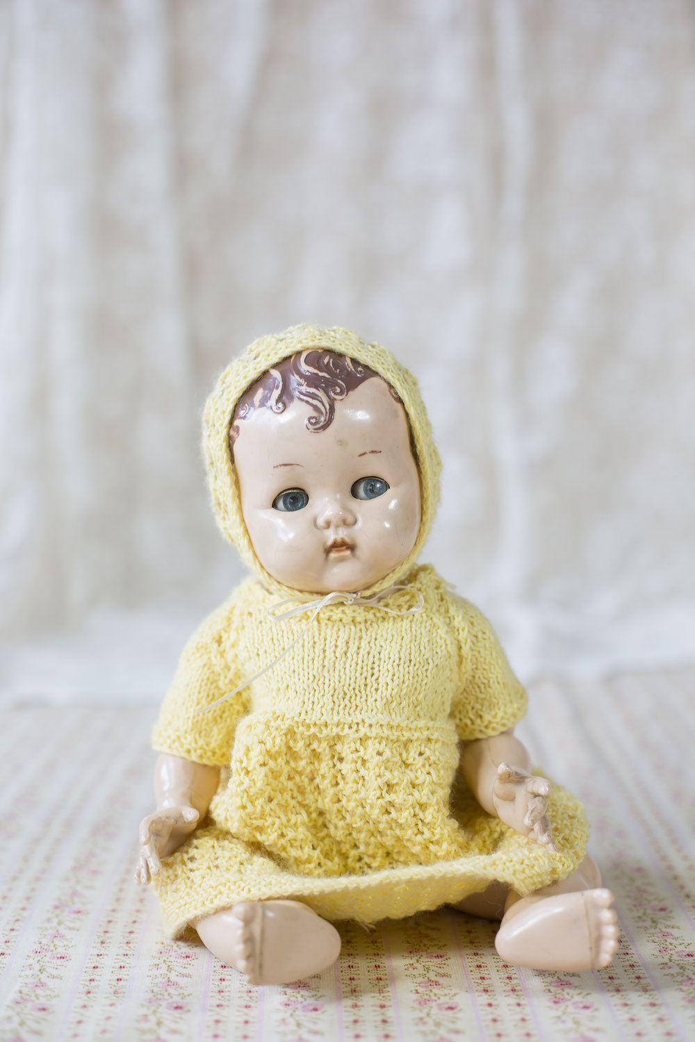 Childhood Pedigree with bent legs. It has painted brown hair, Judith made her do a headstand as a child and broke the dolls head in two, she had to go to the dolls hospital!