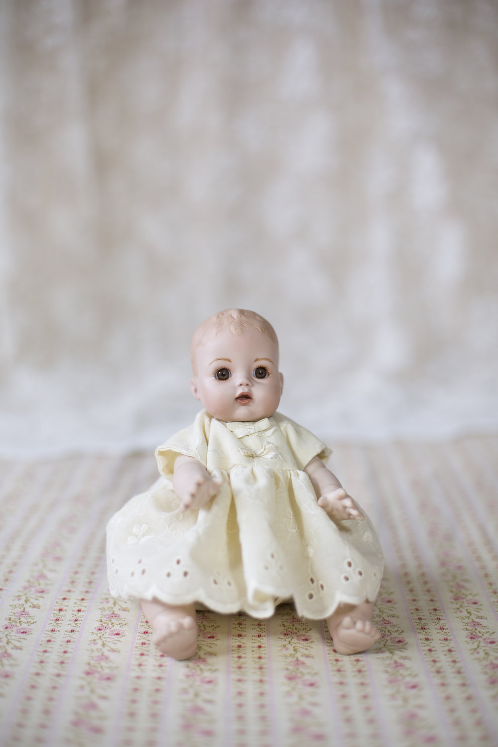 """While in a craft sale on her road in Christchurch,Judith saw this doll and remarked how much she liked it. At the time she was a member of the Christchurch Doll Club (1989-2002) and decided that the doll should became the mascot for the club. In appreciation of the large amounts of orders for the doll following it becoming the Christchurch Doll Club mascot, the doll maker gave Judith this doll as a gift. She has """"To Judy from Wilma Aug 1999"""" inscribed on the back of her head."""
