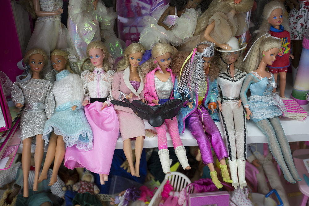 Barbie  dolls. The seven sitting in the front are from the 1970s-1980s, they belonged to Judith's daughters.