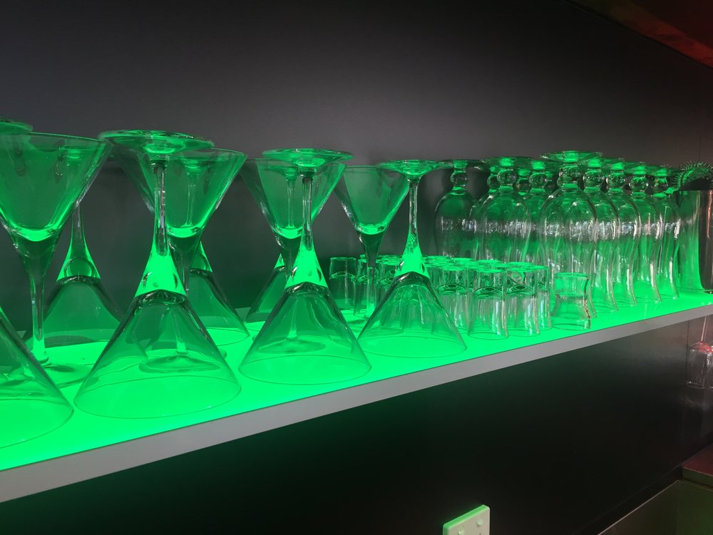 Bar Shelving - The translucency of liquor bottles and glassware amplifies the lighting effect from Pixalux® further enhancing the continuity for themed venue lighting.