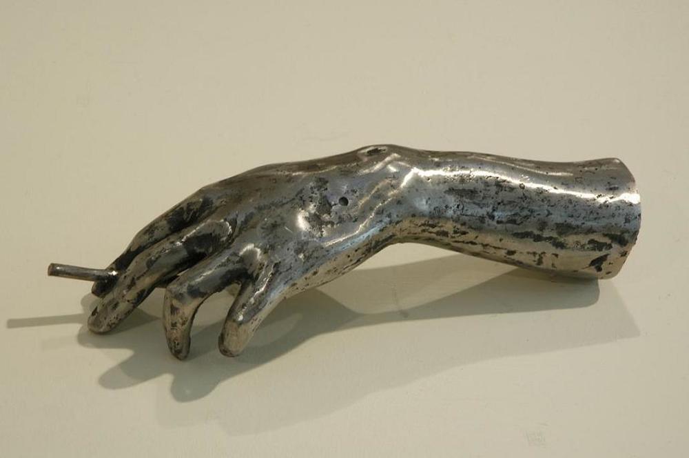 """Smoking Hand""  cast iron  4"" x 13"" x 5 1/2""  2007"