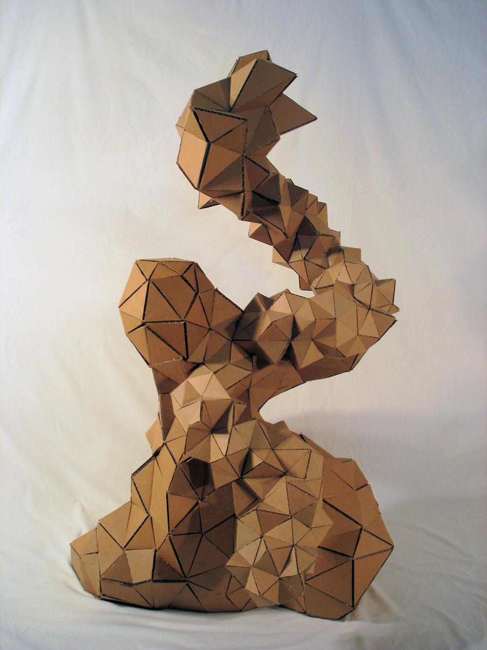 """Vibrato""  newspaper, cardboard, glue  48"" x 28"" x 30""  2006"