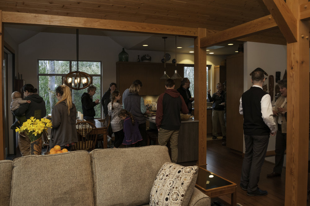 Guests mingling upstairs in the open floor plan.