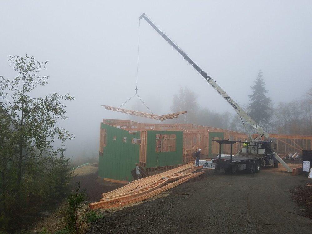 17 roof trusses on crane.jpeg
