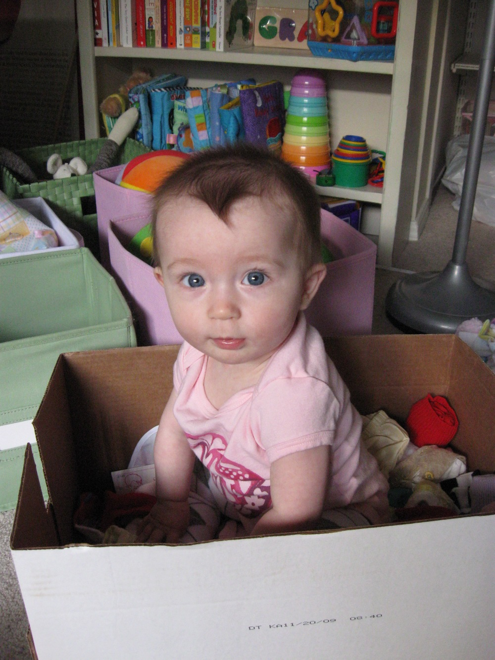 2010 — 7-month-old Grace helping us unpack, in the bedroom we are currently packing up again