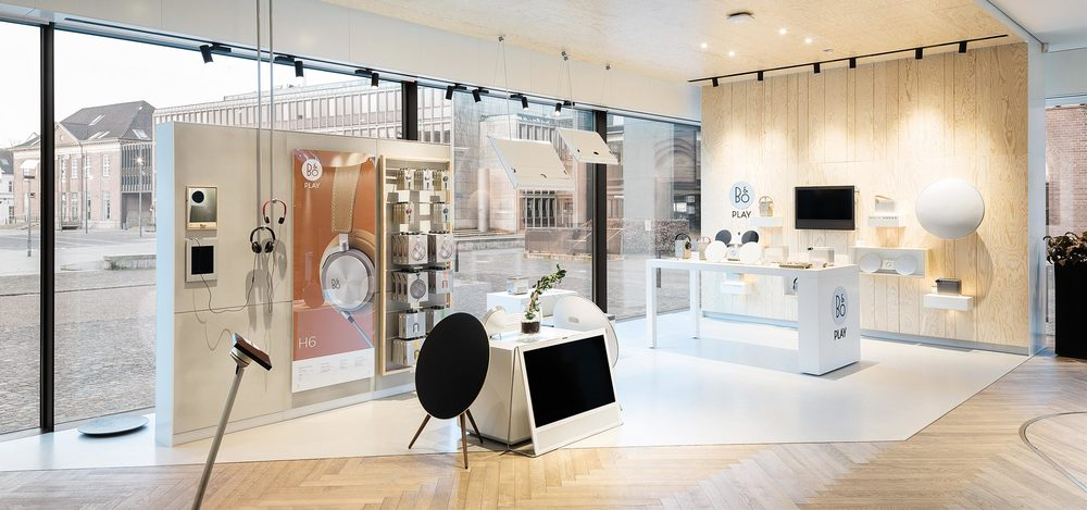 Playful store-in-store concept for B&O Play juxtaposing materials such as glass and wood to create an inviting yet airy atmosphere