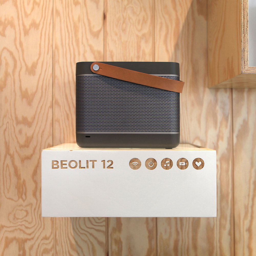 BEOLIT 12 product displayed in a B&O store designed by the shop-in-shop concept of Johannes Torpe Studios