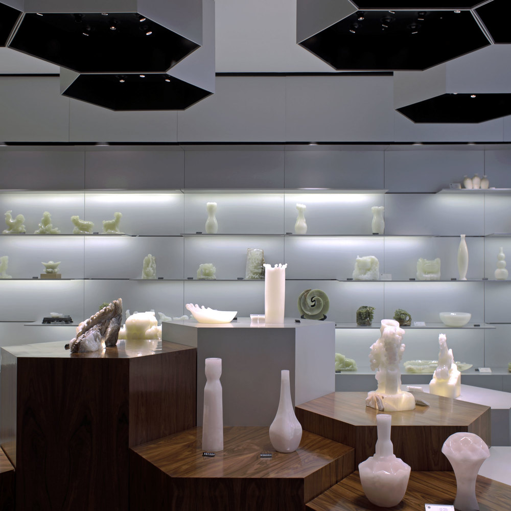 Shelfes in the Skyword Showroom displaying sophistically enlightened onyx figures