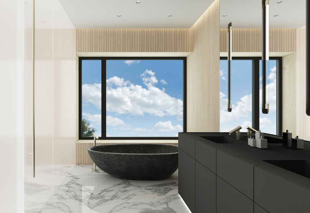 Bathroom at a private villa with residential design by Johannes Torpe Studios
