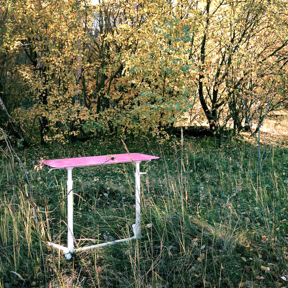 Pink Table designed for Hayworth as part of the Space Enabler product family, photographed in nature