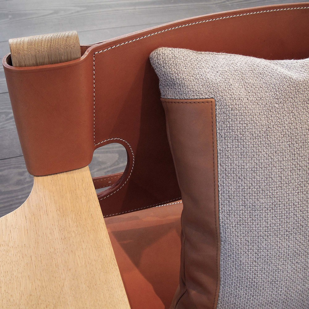 Detail of 'Double Stitch' cushion on a chair of Scandinavian furniture design company Fredericia