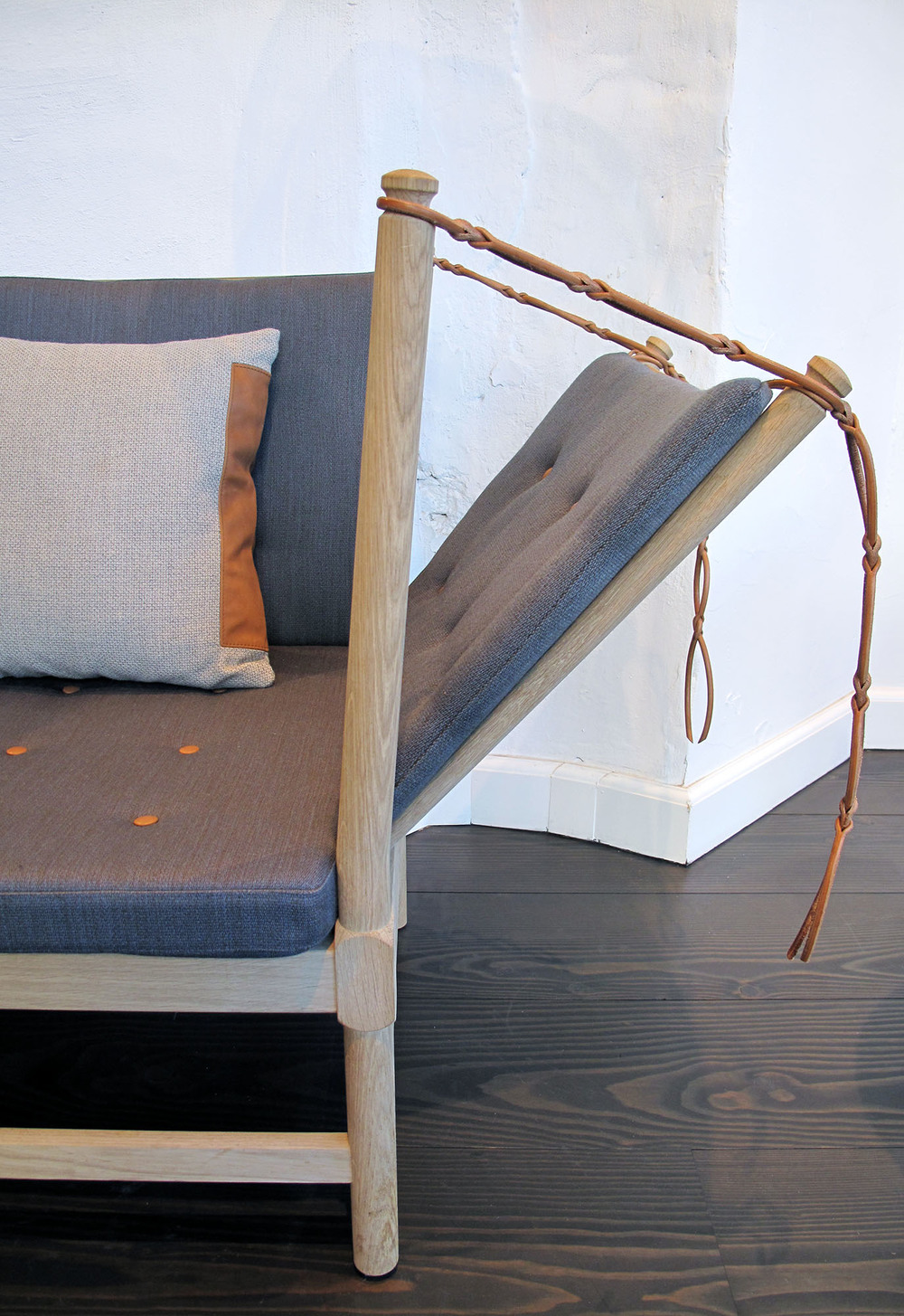 'Double Stitch' cushion on a Danish design sofa