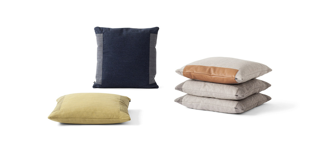 The 'Double Stitch' cushion product design in different colours that was designed by Johannes Torpe for Fredericia furniture