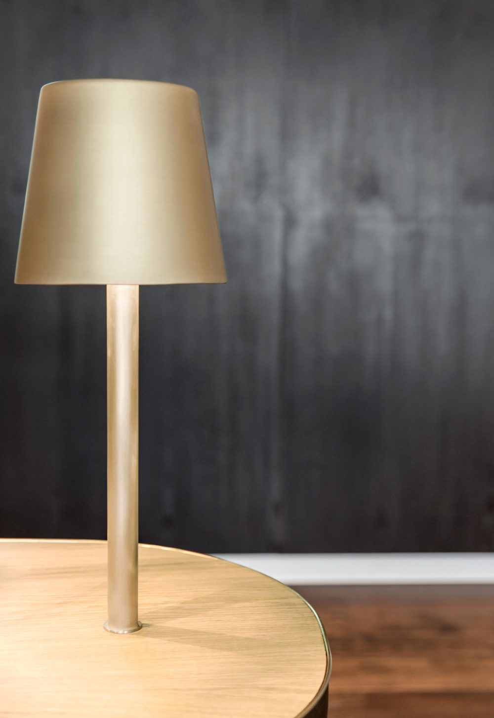 Brass table lamp designed by lighting and furniture designer Tom Dixon