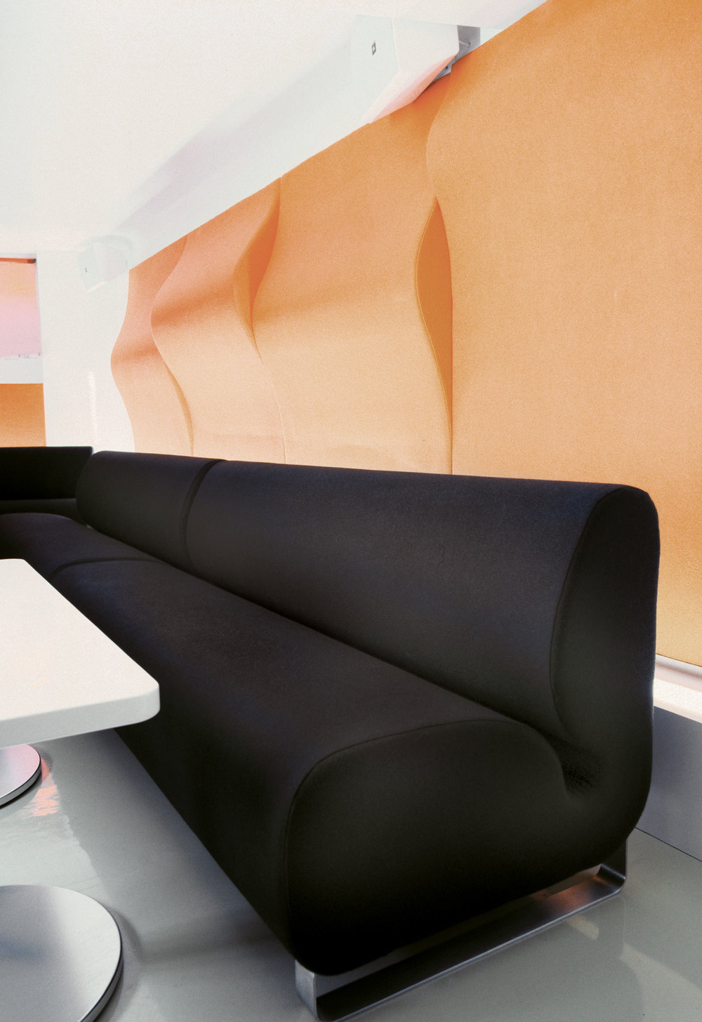 Black custom-designed sofa at Supergeil restaurant