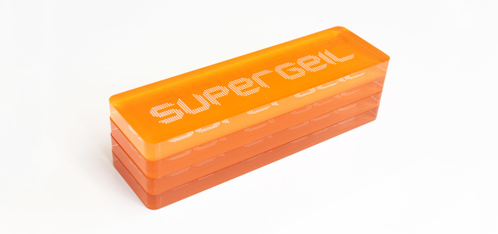 Stacked orange plastic signs with Supergeil brand identity