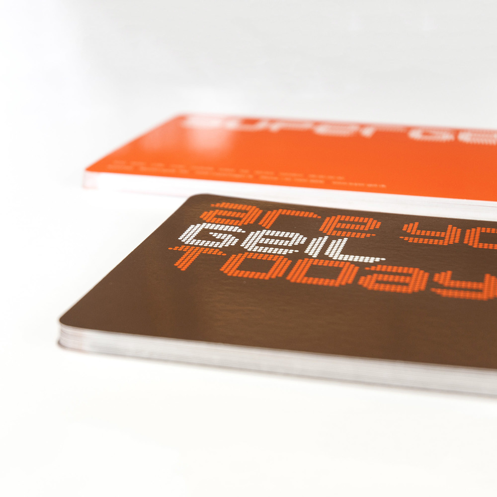 Business cards which are part of the brand identity design for restaurant chain Supergeil