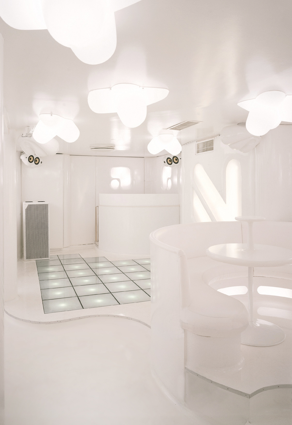 White interior design for NASA Nightclub designed by Johannes Torpe Studios