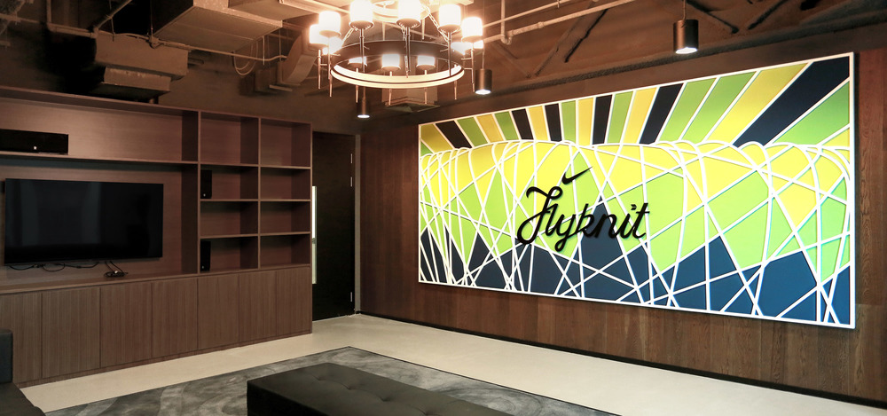 Meeting room at Nike office with branded wall art inspired by the Flyknit sneaker.