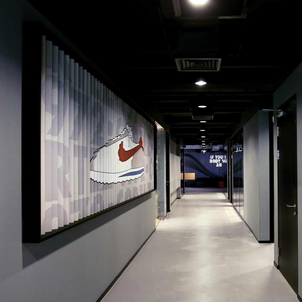 Hallway at Nike office in Beijing with brand installation inspired by sneakers