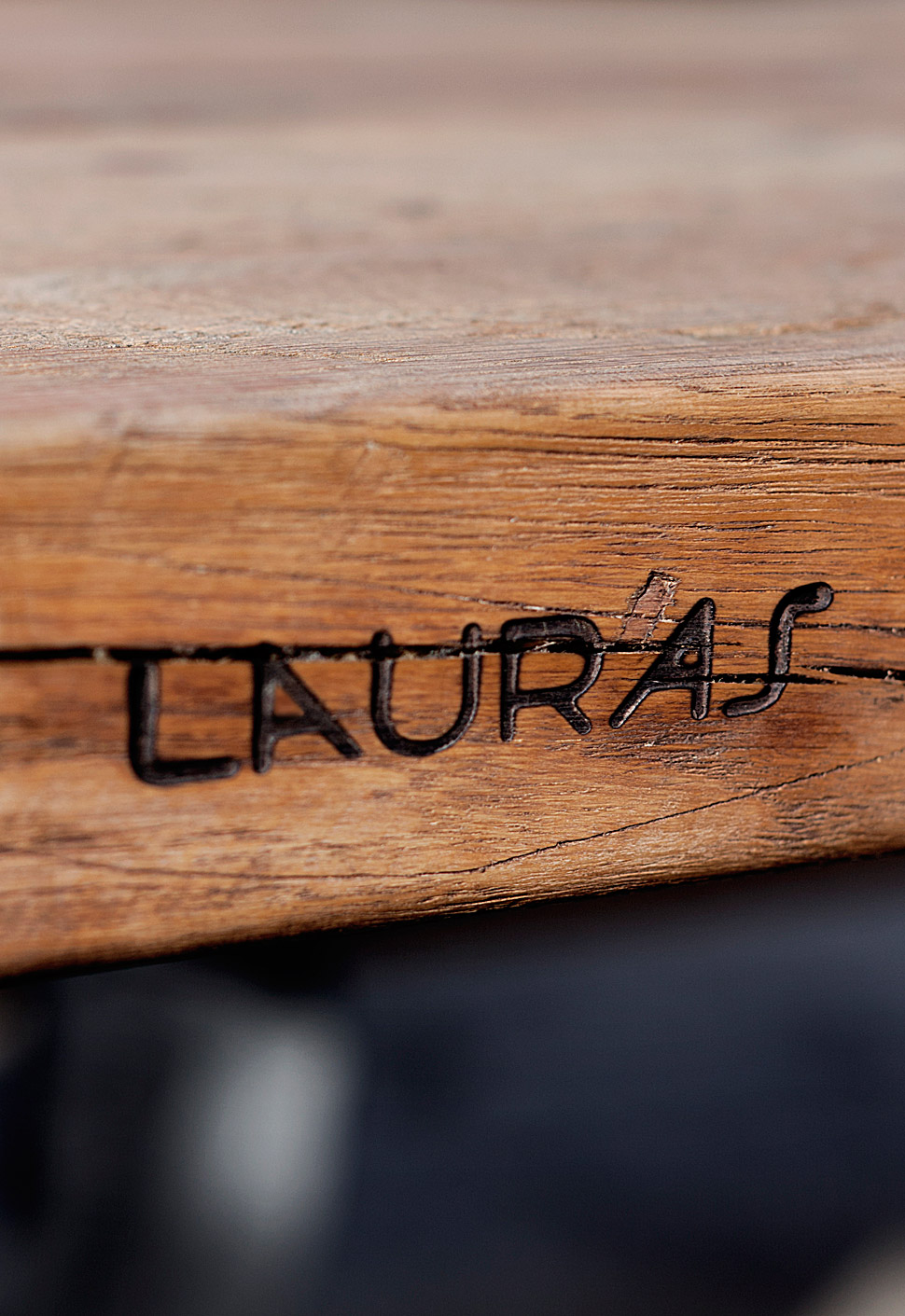 Close-up shot of custom-made logo engraved in wood of Lauras Bakery by Johannes Torpe Studios
