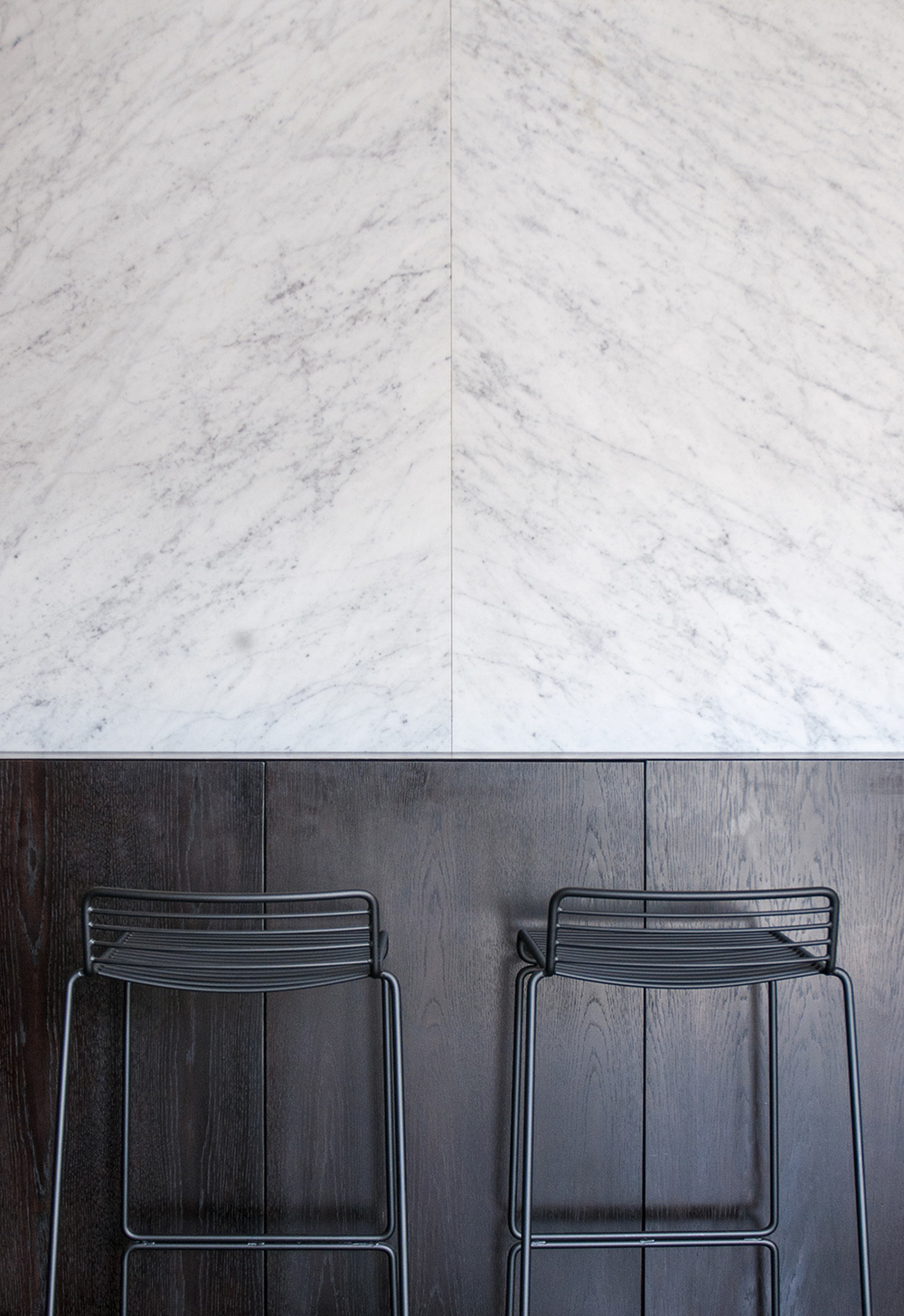 HAY barstools designed in front of a marble wall