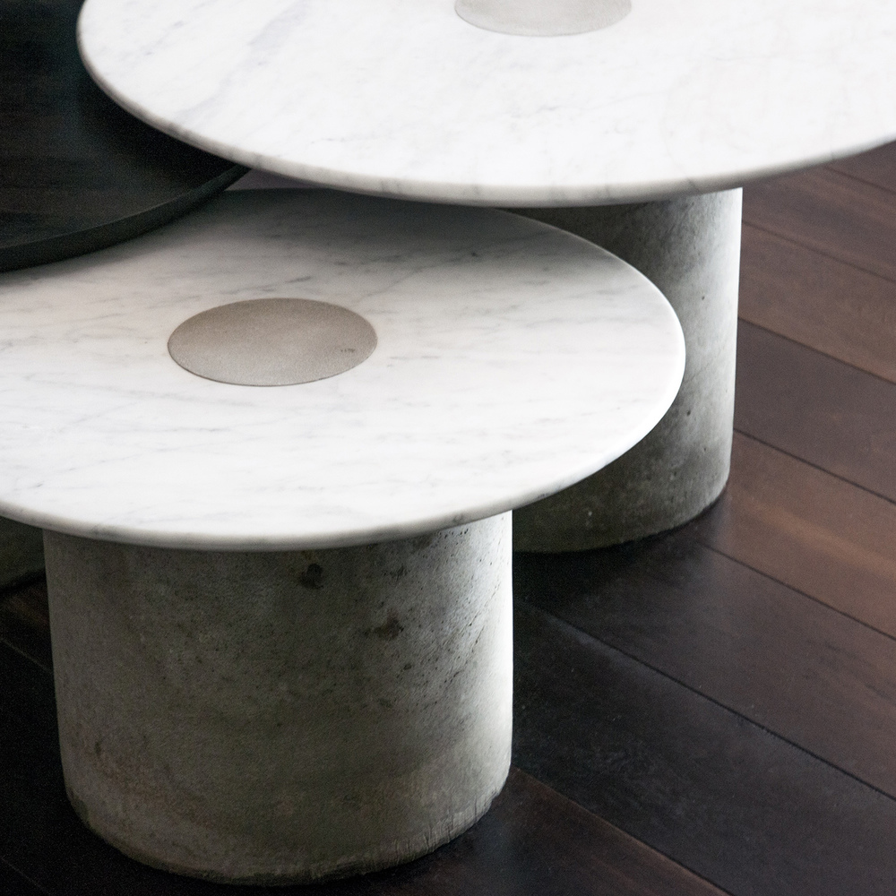Furniture design of three round sidetables of different sizes made out of white marble