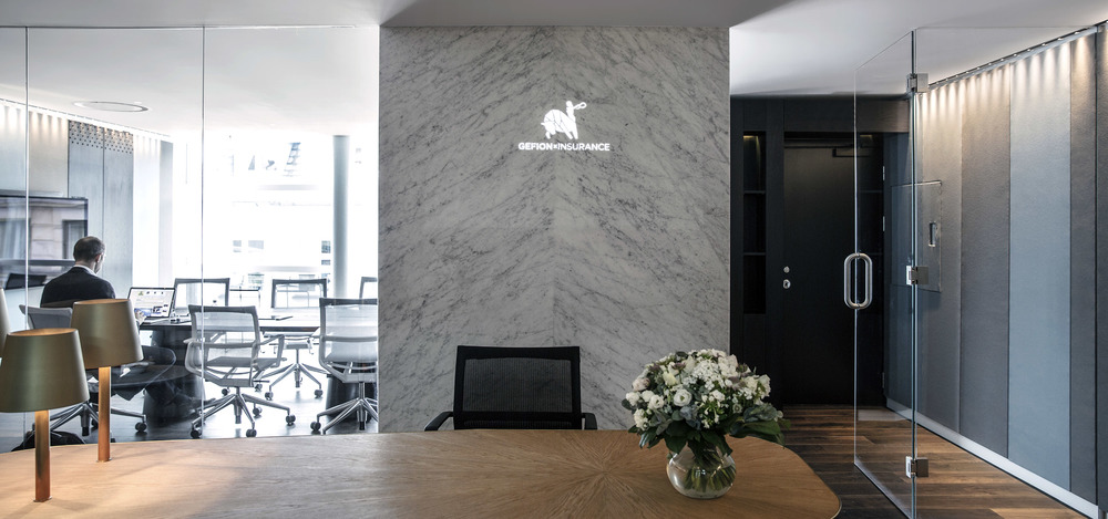 Reception area with desk, chair and bouquet as part of the office design for Gefion Insurance in Copenhagen