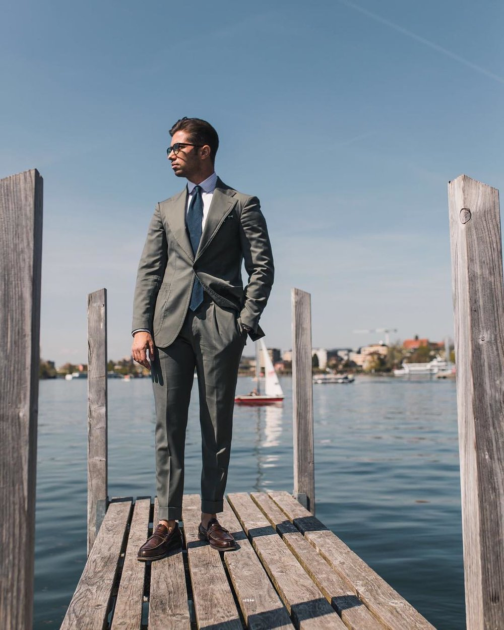 """Sandro is wearing a two piece """"The Amarcord Suit."""" with wide notch lapel, patch pockets and a little ticket patch pocket. Fabric: olive green 130's"""