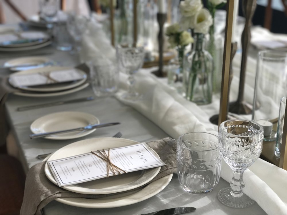 Pale grey table cloths now available 2.2m x 3.2 paired here with sheer white runners and 'natural' 100% linen serviettes