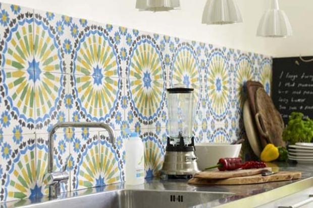 Fresh morrocan tiles make a sharp citrus splash in the kitchen.