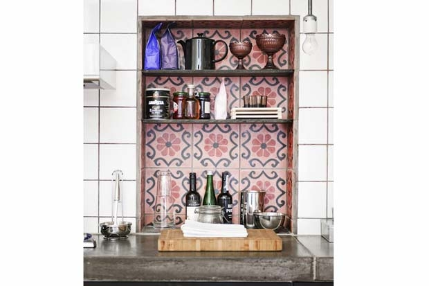 Contrasting rose concrete encaustic tiles make afeature of this shelf nook.