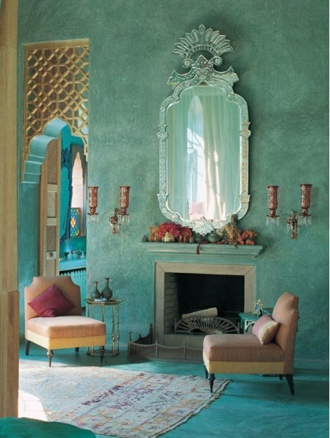 Fretwork screenarchway, cool aqua-wash walls and a decorative fanmirror. A Morroccan edge cleverly combined with European influences.