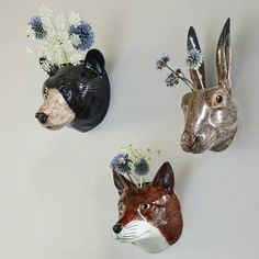 Animal head vases. (Graham & Green) Yes!So cute. Lovely way to bring flowers into a child'sbedroom without the worry of the vase being knockedover with rumbunctious play. And they're stunning.