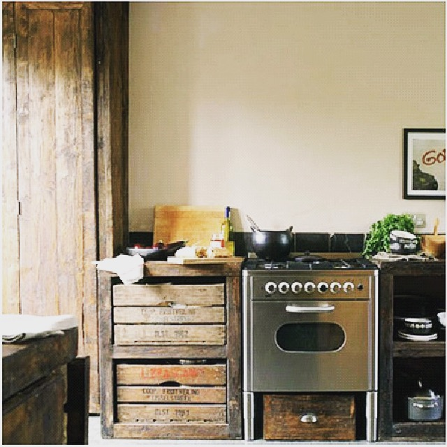 Rustic style kitchen with apple box drawers.