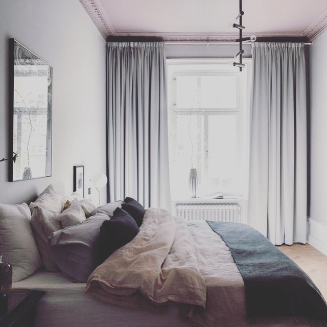 As modern as this seems when combined with the paint colour above, this laid back but luxurious layered bed linen in pinks and greys will work perfectly.