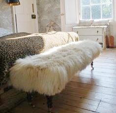 No alpine hotel would not be complete without this at the foot of the bed -goat hair ottoman.