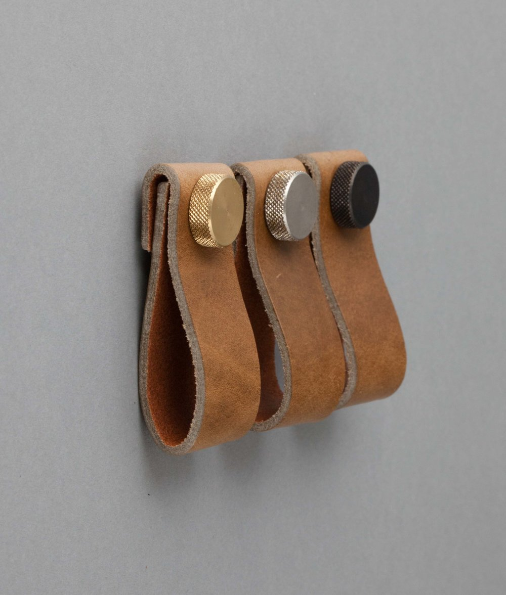 I was over the moon when this trend came in. PLEASING!! Leather pull handles, from  Dowsing and Reynolds . A good place to look btw if you're in the market for hardware.