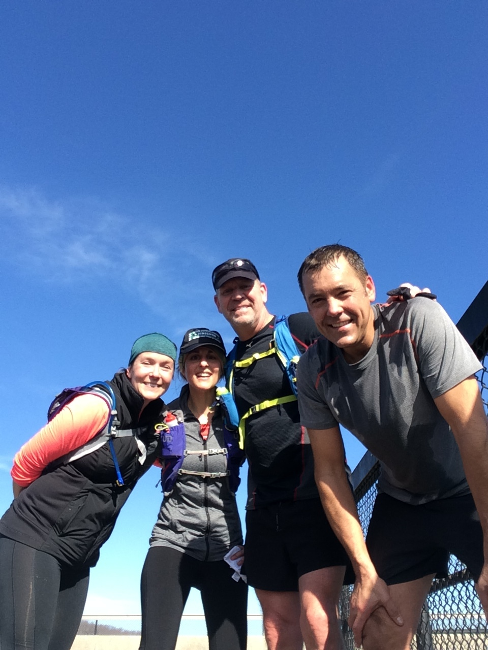 A few of my training pals--Jenny, me, Scott and John--after a particularly tricky trail run that included crawling down the face of a ridiculous hill. Still smiling!