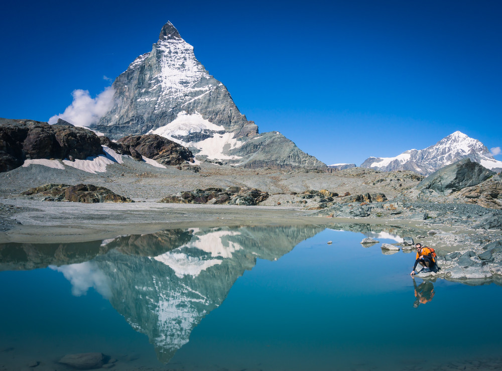 My husband tests the waters of this pond found along the Glacier Trail in Zermatt.  Spectacular view of the Matterhorn were around every corner.