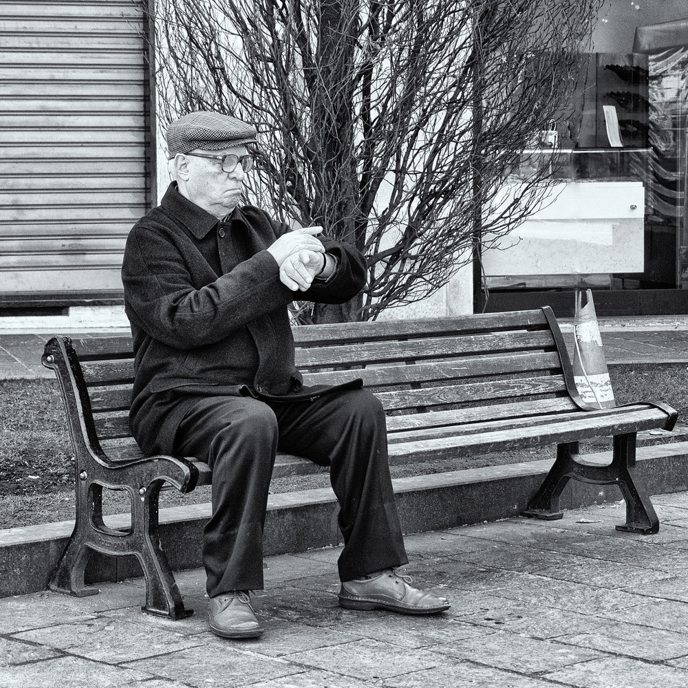 This gentleman waits impatiently on a bench in Piazza Liberta in Sarrono, Italy.