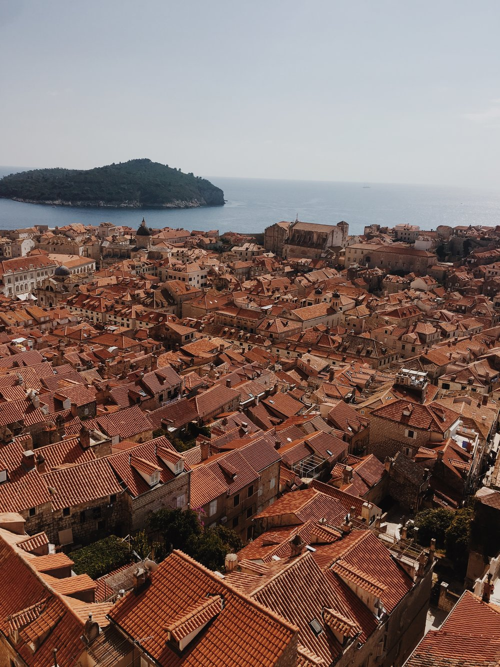 Dubrovnik - I love this photo of Dubrovnik from up above. Taken whilst on the city walks at one of the best photo locations to get a view of the entire city. Beautifully tiled, matching rooftops and the Adriatic in the distance.