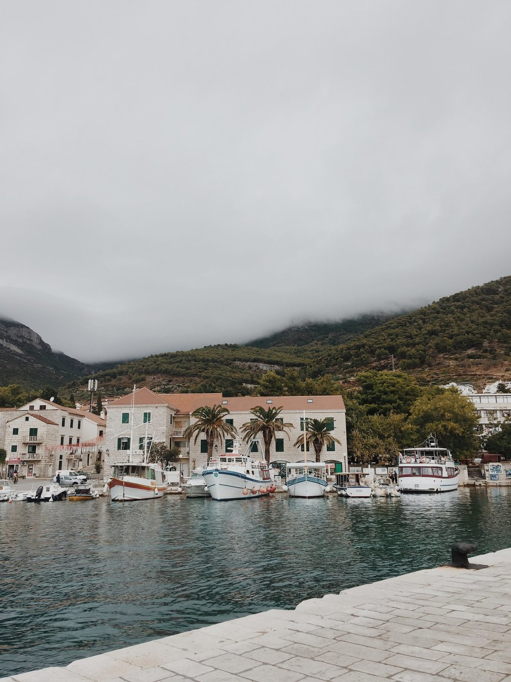 Watching the clouds roll over the mountains whilst waiting for our boat -