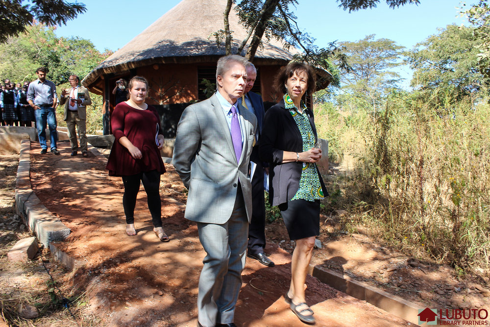 Ambassador Schultz tours library grounds with Jane Meyers
