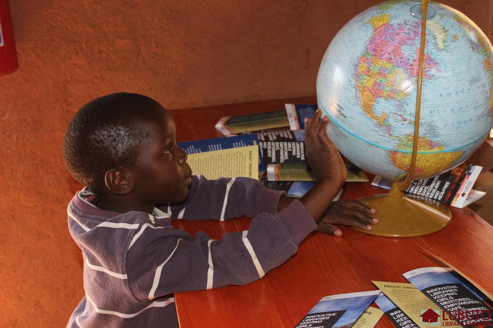 mthunzi-boy-with-globe