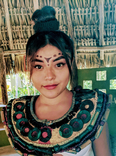 Mayan girls decorate their faces with traditional tattoos.